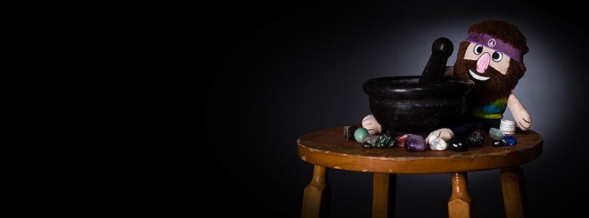 How to Trial and Error Through a Three-Light Studio Setup — A Hippie Sitting On A Stool, Grinding Rocks. Why? Who Knows! He's a Dog Toy.